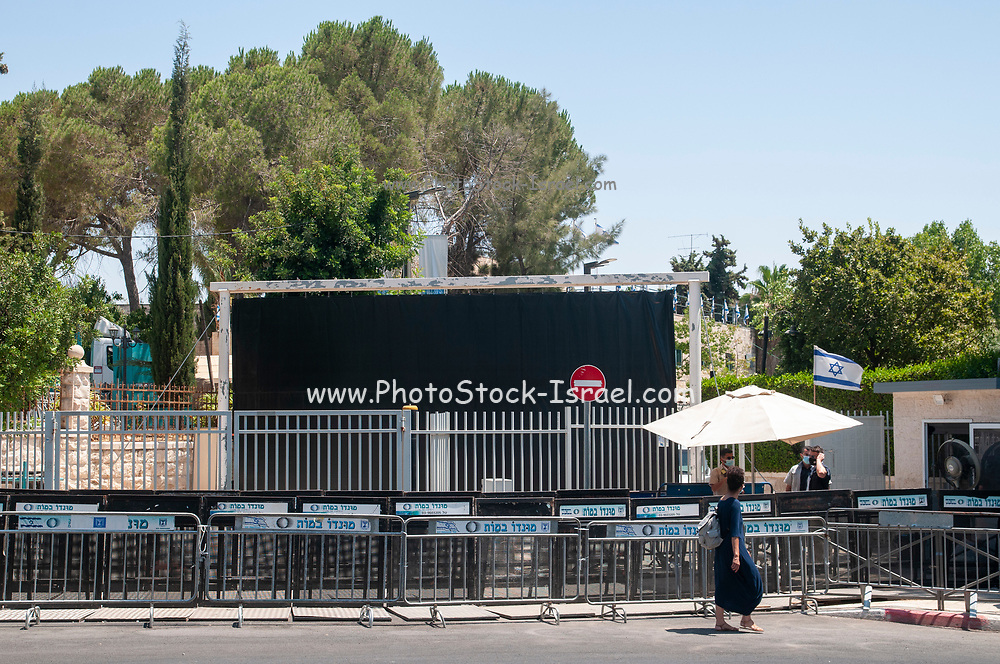 Security guards and policeman stand guard in front of a large black curtain which obscure the entrance to the official residence of Prime Minister Benjamin (Bibi) Netanyahu in Balfour street in West Jerusalem, Israel Photographed on 22 July 2020. This large curtain was erected by Netanyahu to cover the ongoing protest against he alleged crimes of corruption.