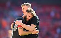 Lincoln City's Jorge Grant, left, hugs James Jones at the end of the game<br /> <br /> Photographer Chris Vaughan/CameraSport<br /> <br /> The EFL Sky Bet League One Play-Off Final - Blackpool v Lincoln City - Sunday 30th May 2021 - Wembley Stadium - London<br /> <br /> World Copyright © 2021 CameraSport. All rights reserved. 43 Linden Ave. Countesthorpe. Leicester. England. LE8 5PG - Tel: +44 (0) 116 277 4147 - admin@camerasport.com - www.camerasport.com