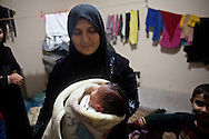 Walid, a four day old boy born as a refugee, one of 182 Syrian children born in the camp. Yayladagi refugee camp for Syrians in southern Turkey. 12/21/2012 Bradley Secker for the Washington Post