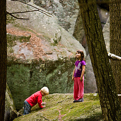 """Kids explore """"The Boulders"""" in New Hampshire's Pawtuckaway State Park."""