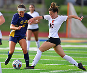 OFallon midfielder Ella Peterson (left) and Edwardsville forward Brynn Miracle fight for possession. OFallon defeated Edwardsville in a girls soccer playoff game at OFallon High School in OFallon, IL on Tuesday June 8, 2021. <br /> Tim Vizer/Special to STLhighschoolsports.com.