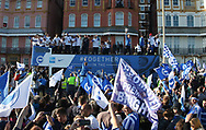 Brighton & Hove Albion central midfielder Steve Sidwell (14) lifts the trophy on the open top bus during the Brighton & Hove Albion Football Club Promotion Parade at Brighton Seafront, Brighton, United Kingdom on 14 May 2017. Photo by Phil Duncan.