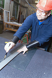 Glazier scoring a pane of glass,