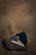 Blue rock on the beach Silver Strand, or Trabane Beach, near Malin Beg, Donegal, on Ireland's Wild Atlantic Way.