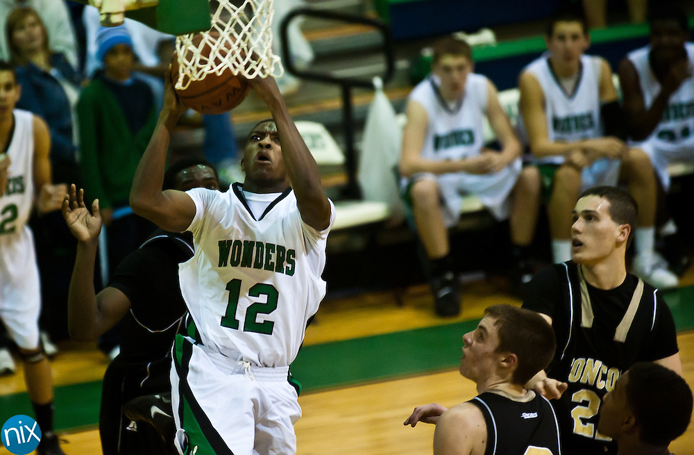 Kannapolis's Damien Washington goes up for a shot against Concord Saturday night at A.L .Brown High School. Concord won the cross-town rivalry 80-73. (Photo by James Nix)