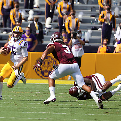 Sep 26, 2020; Baton Rouge, Louisiana, USA; LSU Tigers quarterback Myles Brennan (15) runs against the Mississippi State Bulldogs during the first half at Tiger Stadium. Mandatory Credit: Derick E. Hingle-USA TODAY Sports