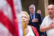 Former Florida Governor and potential Republican presidential candidate Jeb Bush stands for the pledge at an early morning GOP breakfast event March 18, 2015 in Myrtle Beach, South Carolina.