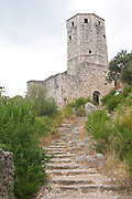 Narrow steep foot path leading up to the tower fortress. Pocitelj historic Muslim and Christian village near Mostar. Federation Bosne i Hercegovine. Bosnia Herzegovina, Europe.