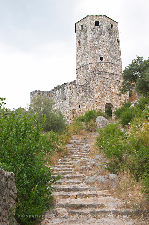 Narrow steep foot path leading up to the tower fortress. Pocitelj historic Muslim and Christian village near Mostar. Federation Bosne i Hercegovine. Bosnia Herzegovina, Europe.