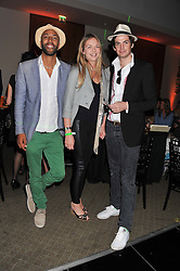 Left to right, TOM CARR, TORI COOK and HUGO HEATHCOTE at the Veuve Clicquot Experience at The Hurlingham Party following the Polo in The Park held at the Hurlingham Club, London SW6 on 8th June 2012.