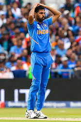 Bhuvneshwar Kumar of India cuts a frustrated figure - Mandatory by-line: Robbie Stephenson/JMP - 09/07/2019 - CRICKET - Old Trafford - Manchester, England - India v New Zealand - ICC Cricket World Cup 2019 - Semi Final