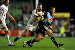Chris Robshaw of Harlequins loses the ball after being tackled by Will Fraser of Saracens - Photo mandatory by-line: Patrick Khachfe/JMP - Mobile: 07966 386802 12/09/2014 - SPORT - RUGBY UNION - London - Twickenham Stoop - Harlequins v Saracens - Aviva Premiership