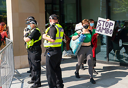 Edinburgh, Scotland, UK. 19 July  2021. Protestors opposed to the approval of new Cambo North Sea oil and gas field occupy HM Government Queen Elizabeth house in central Edinburgh today. Protestors are still inside and outside the building in the afternoon under police watch. Protestors cite global warming and climate change as a reason to leave all new oil and gas deposits in the ground undeveloped. Pic; protestors leave Queen Elizabeth house after occupying the foyer during the day.   Iain Masterton/Alamy Live news.