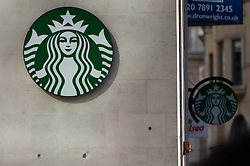 © Licensed to London News Pictures. 16/10/2012. London,UK. A Starbucks Coffee shop in central London on 16 October 2012. Since opening its first coffee shop in the UK in 1998, Starbucks has made over £3bn in sales but paid just £8.6m in income taxes, according to new research. Photo credit : Thomas Campean/LNP.