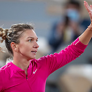 PARIS, FRANCE October 02. Simona Halep of Romania celebrates her victory against Amanda Anisimova of the United States in the third round of the singles competition on Court Philippe-Chatrier during the French Open Tennis Tournament at Roland Garros on October 2nd 2020 in Paris, France. (Photo by Tim Clayton/Corbis via Getty Images)