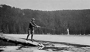 1307B-07. Fishing through the clearing ice on Wahtum Lake, among the headwaters of Eagle Creek on Chinidere Mountain in the Mt. Hood National Forest.