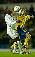 Photo. Jed Wee<br /> Leeds United v Southampton, FA Barclaycard Premiership, Elland Road, Leeds. 26/08/2003.<br /> Leeds' Zoumana Camara (L) and Southampton's Gavin McCann scrap for possession.