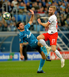 November 5, 2019, St. Petersburg, Russia: Russia. St. Petersburg. November 5, 2019. Zenit players Magomed Ozdoev and RB Leipzig Conrad Laimer (left to right) in the UEFA Champions League group stage match between the Zenit teams (St. Petersburg, Russia) and RB Leipzig  (Credit Image: © Andrey Pronin/ZUMA Wire)
