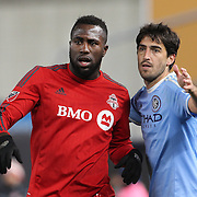 NEW YORK, NEW YORK - November 06:  Jozy Altidore #17 of Toronto FC jostles for position with Andoni Iraola #51 of New York City FC during the NYCFC Vs Toronto FC MLS playoff game at Yankee Stadium on November 06, 2016 in New York City. (Photo by Tim Clayton/Corbis via Getty Images)