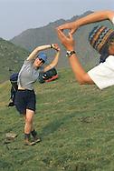 Doing yoga stretches on a hike in Kluane, Yukon