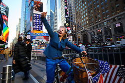 © Licensed to London News Pictures. 07/11/2016. New York CIty, USA. A Democrat supporter who dressed as Hilary Clinton campaigns in Times Square, New York City on Monday, 7 November, the day before the presidential election day in the United States of America. Photo credit: Tolga Akmen/LNP