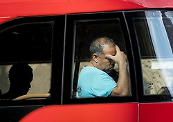 © Licensed to London News Pictures. 26/07/2018. London, UK. A bus passenger feels the heat as London experiences the hottest day of the year so far. Photo credit: Peter Macdiarmid/LNP