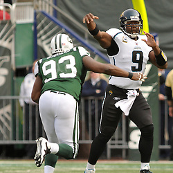 Nov 15, 2009; East Rutherford, NJ, USA; Jacksonville Jaguars quarterback David Garrard (9) passes away from the pursuit of New York Jets defensive end Marques Douglas (93) during first half NFL action between the New York Jets and Jacksonville Jaguars at Giants Stadium.