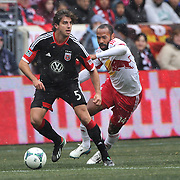Dejan Jakovic, D.C. United, (left) is challenged by Thierry Henry, New York Red Bulls,  in action during the New York Red Bulls V D.C. United, Major League Soccer regular season match at Red Bull Arena, Harrison, New Jersey. USA. 16th March 2013. Photo Tim Clayton