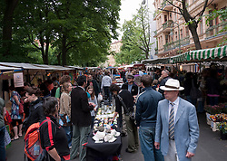 Busy weekend street market on Kollwitzplatz in Prenzlauer Berg district of Berlin Germany