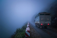 Truck slowly drives along a precarious section of the Ma Pi Leng Pass between Dong Van and Meo Vac, Ha Giang Province, Vietnam, Southeast Asia