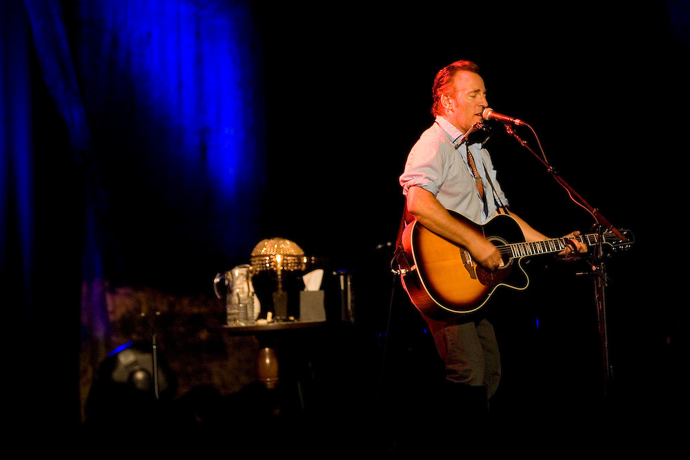 Bruce Springsteen stands at the microphone while in concert at the Paramount Theater in Asbury Park.