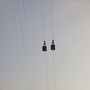 Cable cars taking tourists and sightseers to and from the top of Sugar Loaf Mountain, one of the iconic tourist destinations in Rio de Janeiro. Rio de Janeiro, Brazil. 28th August 2010. Photo Tim Clayton.