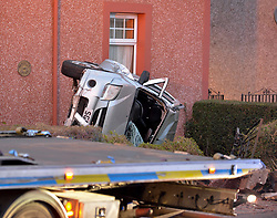 A car crashed into the front of a house in Armadale, West Lothian today. The road was closed for a time to allow for recovery of the car, which ended up on it's side.<br /> <br /> © Dave Johnston / EEm