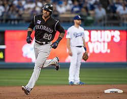 May 22, 2018 - Los Angeles, CA, U.S. - LOS ANGELES, CA - MAY 22: Colorado Rockies' Ian Desmond (20) rounds the bases after hitting a solo homer in the second inning during a Major League Baseball game between the Colorado Rockies and the Los Angeles Dodgers on May 22, 2018 at Dodger Stadium in Los Angeles, CA. (Photo by Kyusung Gong/Icon Sportswire) (Credit Image: © Kyusung Gong/Icon SMI via ZUMA Press)