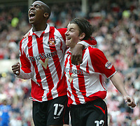 Photo. Andrew Unwin.<br /> Sunderland v Derby County, Nationwide League Division One, Stadium of Light, Sunderland 27/03/2004.<br /> Sunderland's John Oster (r) celebrates scoring his goal with team-mate Darren Byfield (l).