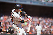 San Francisco Giants catcher Buster Posey (28) makes contact with the ball against the Arizona Diamondbacks at AT&T Park in San Francisco, Calif., on August 31, 2016. (Stan Olszewski/Special to S.F. Examiner)