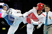 Mcc0041438 . Daily Telegraph..DT Sport..2012 Olympics..Team GB's Jade Jones vs Serbia's Dragana Gladovich in the Taekwondo  -57 kg preliminary rounds at the ExCel centre...9 August 2012....