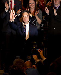 © London News Pictures. 24/09/2013 . Brighton, UK.  Labour party leader ED MILIBAND waves to the crowd after delivering his Key-note speech on the third day of the Labour Party Conference in Brighton. Photo credit : Ben Cawthra/LNP