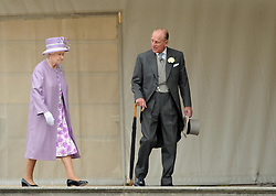File photo dated 29/05/12 of Queen Elizabeth II and the Duke of Edinburgh attending a garden party at Buckingham Palace in London. The Duke of Edinburgh has died, Buckingham Palace has announced. Issue date: Friday April 9, 2020.. See PA story DEATH Philip. Photo credit should read: Anthony Devlin/PA Wire