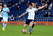 Graham Dorrans has a shot during the The FA Cup match between West Bromwich Albion and Gateshead at The Hawthorns, West Bromwich, England on 3 January 2015. Photo by Alan Franklin.