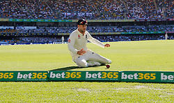 England's Dawid Malan saves a boundary during day two of the Ashes Test match at The Gabba, Brisbane.