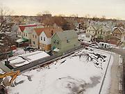 An empty lot in a residential neighborhood.