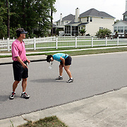MT. PLEASANT, SC, May 31, 2007:  B.J. and Bo Wie, the mother and father of golfer Michelle Wie, look for her ball that rolled into a sewer after she hit it out of bounds during a controversial round. Wie withdrew a few holes later with two still to play after shooting an 86 and coming perilously close to being prohibited from playing the rest of the year on the LPGA tour.