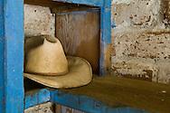 Old straw cowboy hat on shelf, Leo Carillo Ranch Historic Park, near Carlsbad, San Diego County, California
