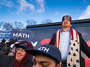 "10 DECEMBER 2019 - DES MOINES, IOWA: ANDREW YANG speaks in front of his bus parked at the Iowa State Capitol during a rally before the start of his bus tour. ang's supporters frequently wear hats with MATH embroidered on them. MATH is one of the slogans of his campaign and stands for ""Make America Think Harder."" Yang, an entrepreneur, is running for the Democratic nomination for the US Presidency in 2020. He kicked off a five day bus tour today at the Iowa State Capitol in Des Moines. Iowa hosts the the first election event of the presidential election cycle. The Iowa Caucuses will be on Feb. 3, 2020.        PHOTO BY JACK KURTZ"