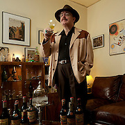 """Jay Hendrickson is the world's leading authority on Legendre Herbsaint, the absinthe substitute created by J. Marion Legendre. He collects Herbsaint bottles and all related paraphenalia from the 1930s-1950s. Jay is responsible for the Original Herbsaint recipe being reintroduced and made available worldwide. Antique mini bottles he collected were used to chemically identify the """"original recipe"""".<br /> This image and a related story titled, """" The Informant"""", was published in the March/April 2010, Imbibe Magazine. <br /> Story by Robert Simonson <br /> Photos by Damian Hevia"""