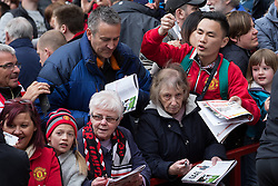 © Licensed to London News Pictures . 17/05/2015 .  Pre match autograph hunters . 0-0 . Manchester Utd vs Arsenal at Old Trafford Football Stadium , Manchester . Photo credit : Joel Goodman/LNP