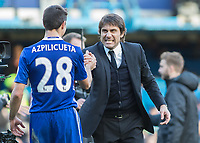 Football - 2016 / 2017 Premier League - Chelsea vs. West Bromwich Albion<br /> <br /> Chelsea Manager Antonio Conte grits his teeth as he congratulates Cesar Azpilicueta after their win at Stamford Bridge.<br /> <br /> COLORSPORT/DANIEL BEARHAM