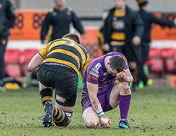 Players find themselves exhausted after the final whistle.<br /> <br /> Photographer Simon Latham/Replay Images<br /> <br /> Principality Premiership - Newport v Ebbw Vale - Sunday 4th February 2018 - Rodney Parade - Newport<br /> <br /> World Copyright © Replay Images . All rights reserved. info@replayimages.co.uk - http://replayimages.co.uk