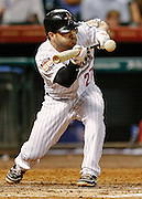 Sept 12, 2012; Houston, TX, USA; Houston Astros second baseman Jose Altuve (27) attempts a drag bunt against the Chicago Cubs during the sixth inning at Minute Maid Park. Mandatory Credit: Thomas Campbell-US PRESSWIRE